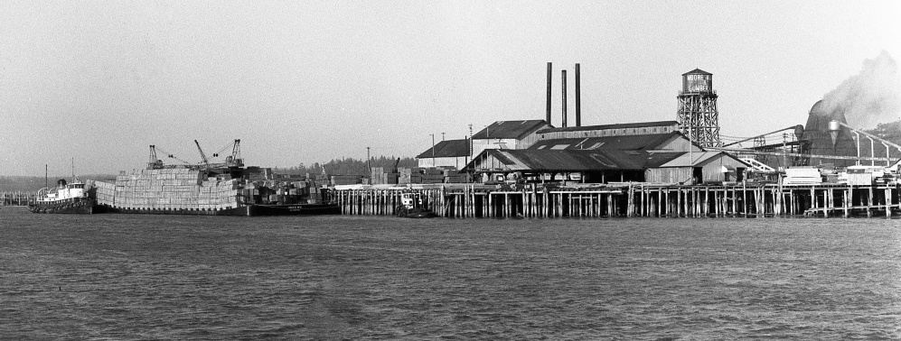 Barge stacked with lumber, 1958