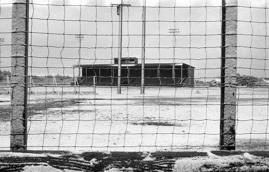 Wooden grandstand after a snowstorm
