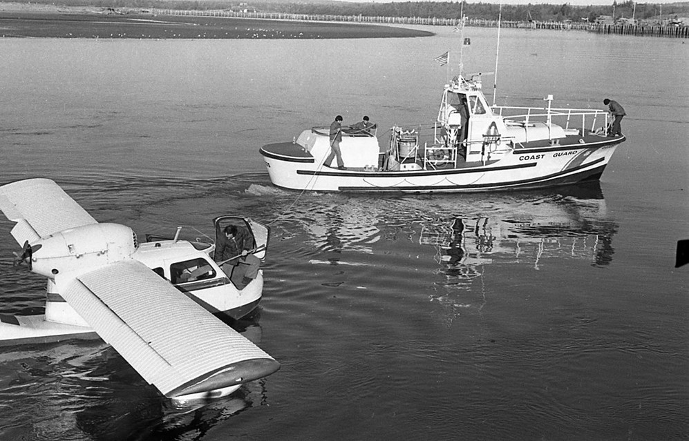 Coast Guard tows float plane, 1974