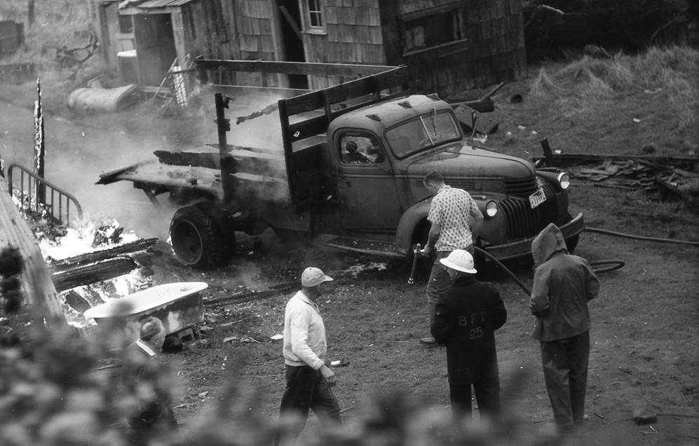Firefighters battle a blaze, 1962