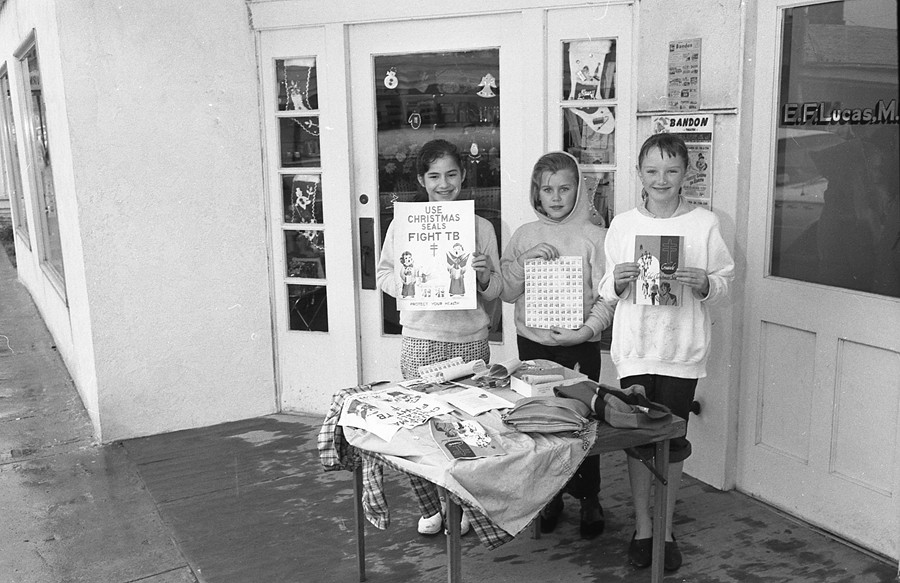 Campfire Girls selling Christmas Seals, 1960