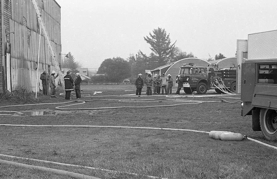 Preparing to burn down the old gym, 1980