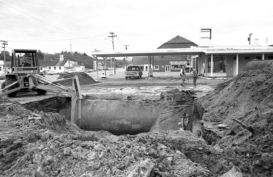 Tanks being dug up alongside the Shell station, 1977