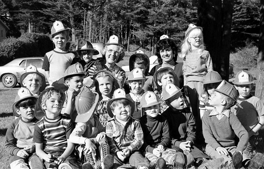 Children wearing firefighter's helmets 1973