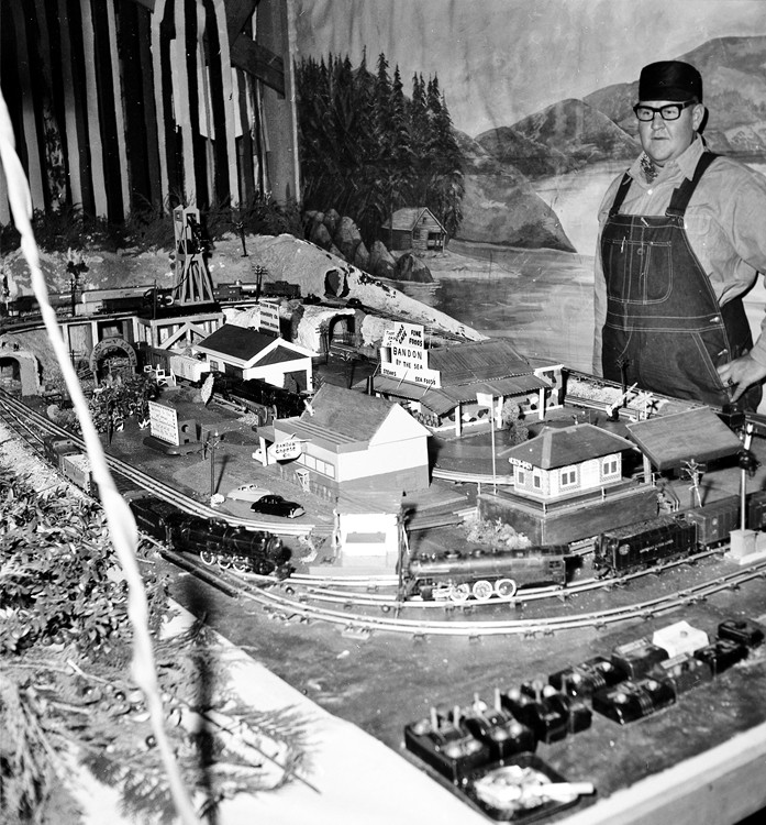 Sid Dominy with his model train set